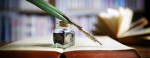 Quill Pen with Ink and Book