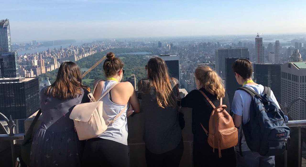 Teenagers overlooking New York City